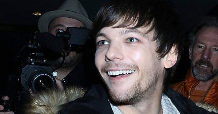 Louis Tomlinson hört sich One Direction gerne mit Alkohol an