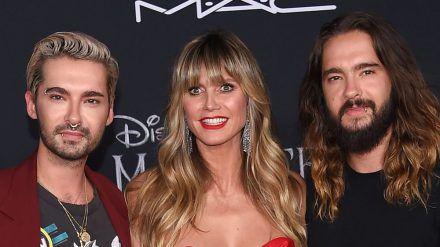 Gemeinsam auf dem roten Teppich: Heidi Klum mit Ehemann Tom Kaulitz (r.) und dessen Zwillingsbruder Bill Kaulitz bei einer Veranstaltung (ili/spot)